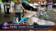 邯郸:路面塌陷 保安雨中守护安全